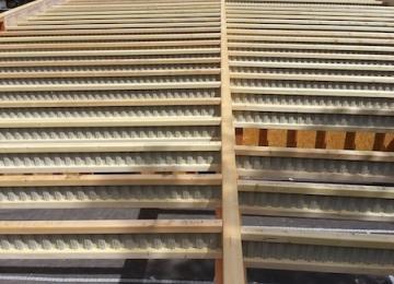 Pose du toit plat en poutres Nailweb